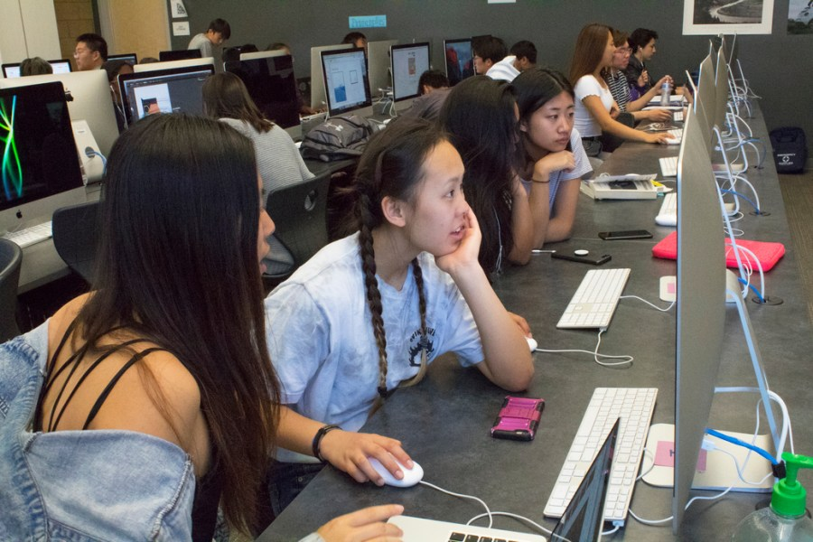 Co-editors-in-chief and sophomores Maddy Noh and Grace Tu brainstorm new ideas for the yearbook during class.
