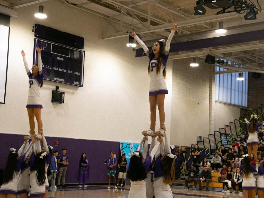 """Junior Jessalyn Nguyen chants """"victory!"""" while in her stunt. Nguyen is one of the team's many fliers, and has been a flier for three years"""