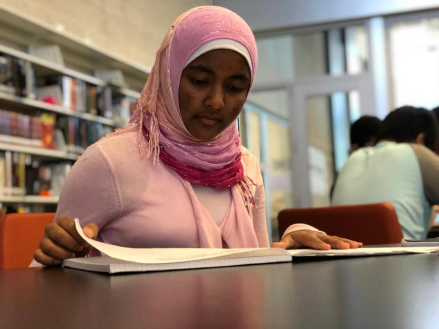 Sabreen+studies+for+her+AP+Physics+1+class+in+the+Student+Union%2C+working+hard+to+maintain+her+demanding+workload.+In+her+free+time%2C+she+also+manages+a+Scratch+program+intended+for+third+and+sixth+graders+at+Ardent+Academy.