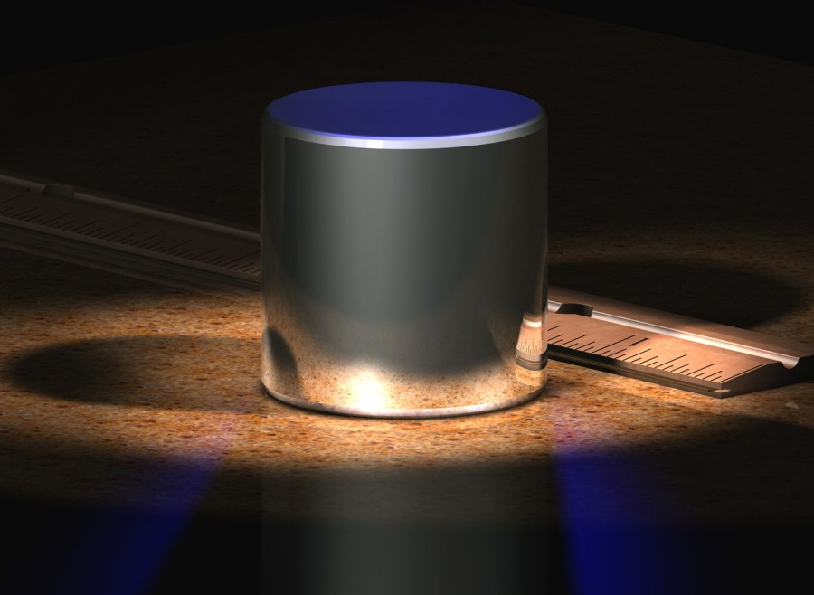 The cylinder is a computer-generated model of the old International Prototype Kilogram (IPK).