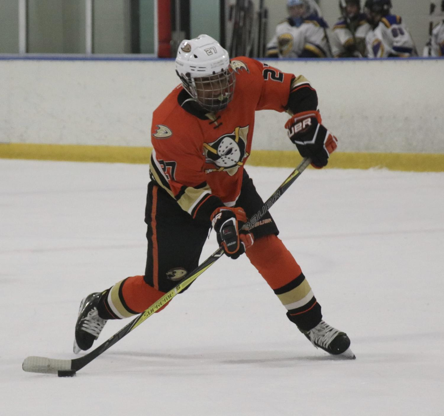 In a rapid counter attack, Manan Mendiratta prepares to slap the puck across the ice into the netting. His travel team, the Anaheim Junior Ducks, is one of the top three in California.