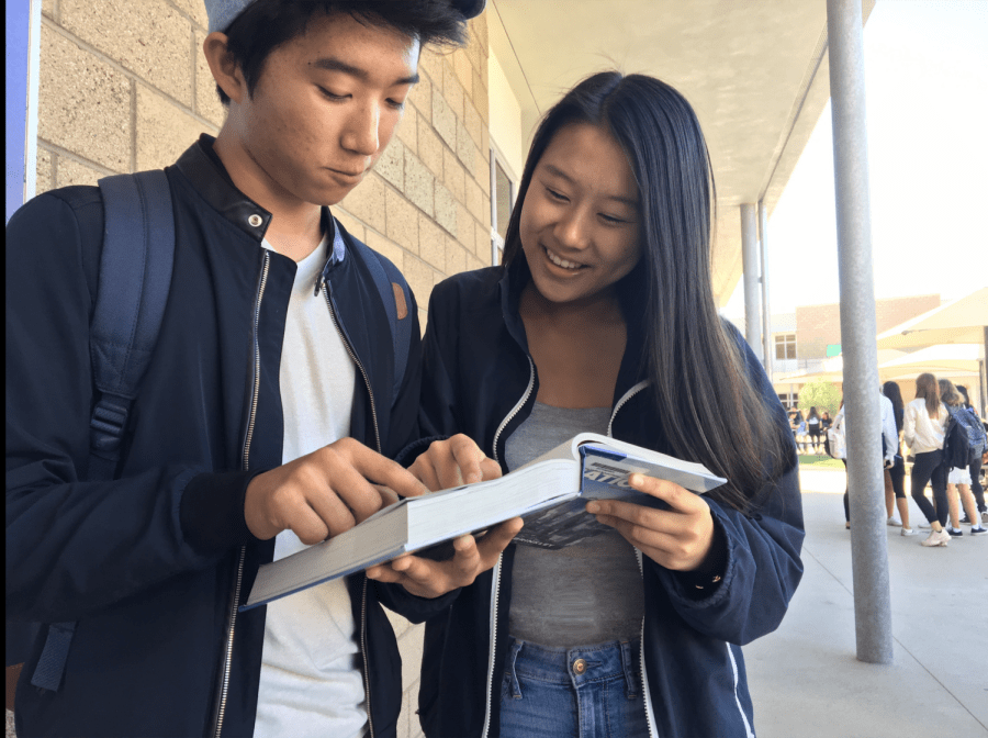 Junior+Stephanie+Zhang+and+freshman+Ryan+Jung%2C+collaborators+in+developing+Portola%E2%80%99s+new+philosophy+class%2C+point+out+references+to+philosophical+topics+in+the+AP+U.S.+History+textbook.+
