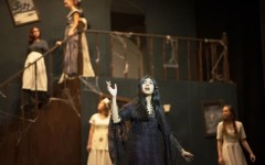"""Morticia Addams(Anar Bhatt) sings """"Death Is Just Around The Corner"""" after realizing Wednesday(Rachel Abalos) and Gomez(Nishad Francis) are keeping a secret from her."""