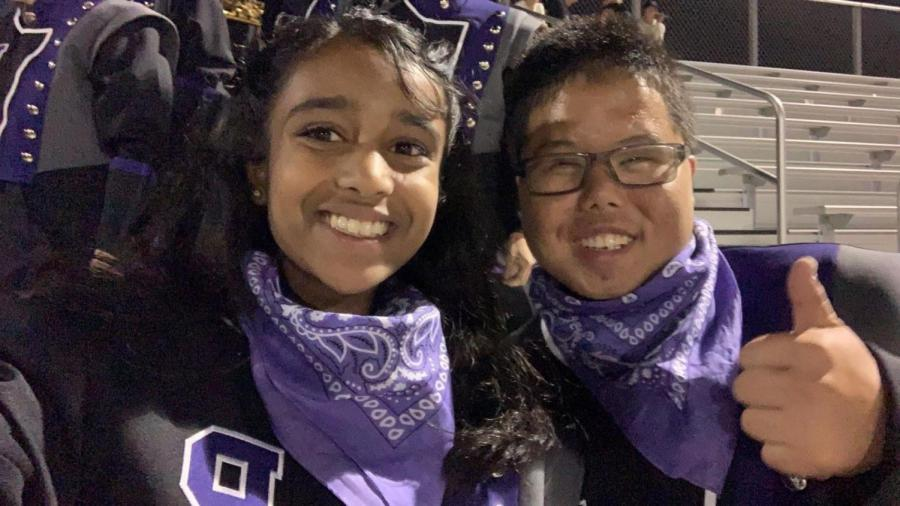 Sophomores+Pranathi+Kollolli+and+Joshua+Ong+celebrate+at+one+of+the+football+games+this+year.+The+pair+were+members+of+the+marching+band+pit+section+this+year+and+spent+time+working+together%2C+playing+cymbals%2C+and+enjoying+the+experience%0A