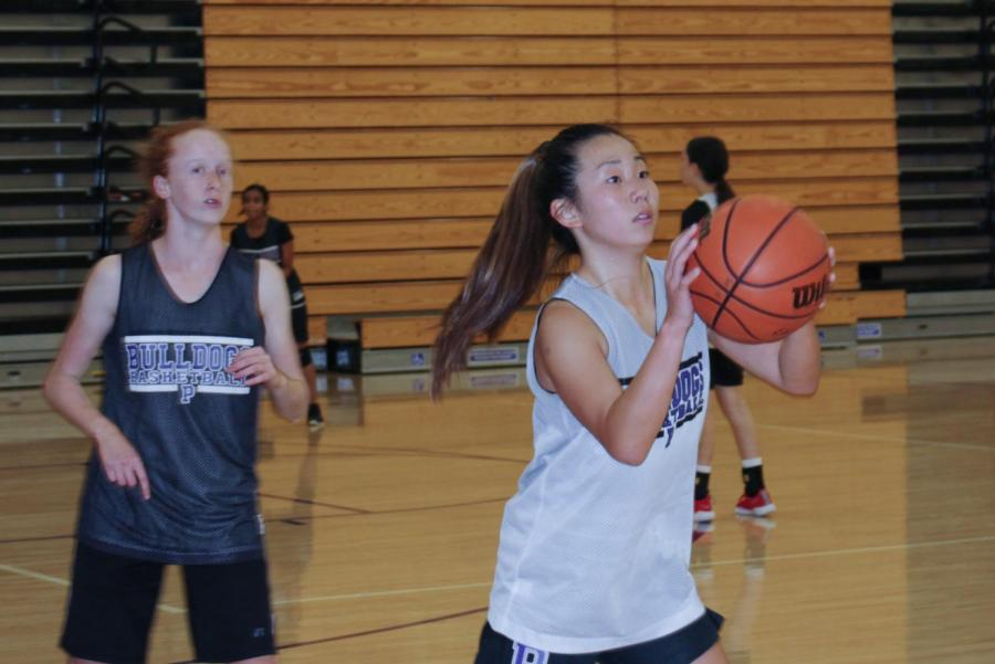 Freshman Moka Saiki shoots a two-point shot during practice to prepare for the upcoming winter season. The next varsity girls' basketball game will be on Nov. 21 at 7 p.m. against Capistrano Valley High.