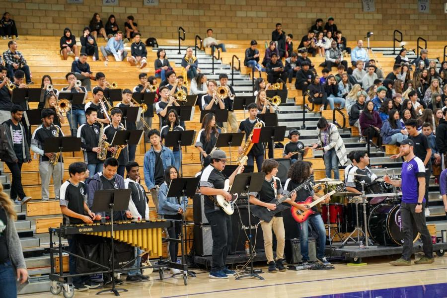 """The Pride of Portola Jazz Ensemble led by music teachers Desmond Stevens and Kyle Traska perform pep tunes on the stands, heightening the team spirit of students on the stand and players. Among the pieces played were """"Blitzkrieg Bop,"""" """"Celebration"""" and """"Everybody Dance Now."""""""