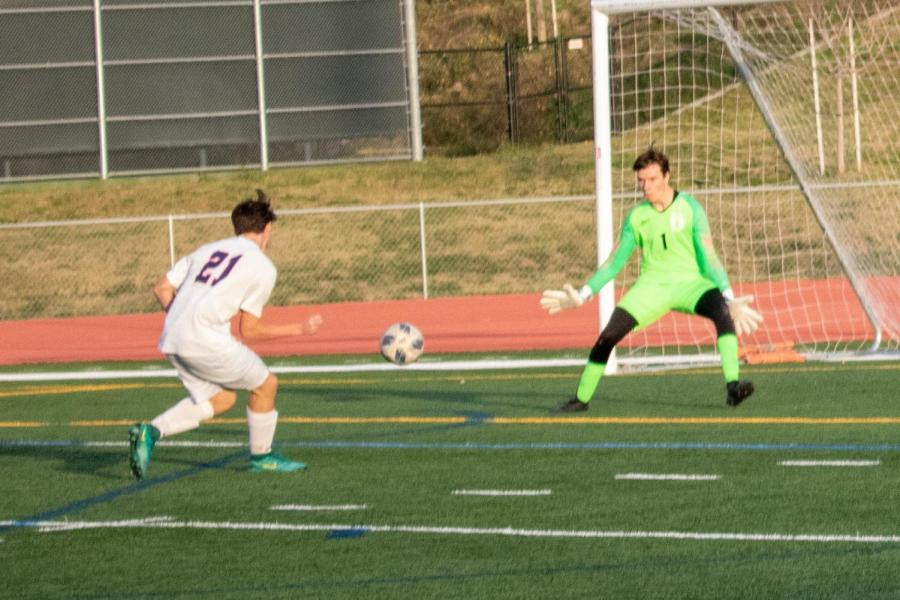 Senior Ethan Dru saves a shot on goal, just one of the many scoring opportunities he took away from Beckman High.