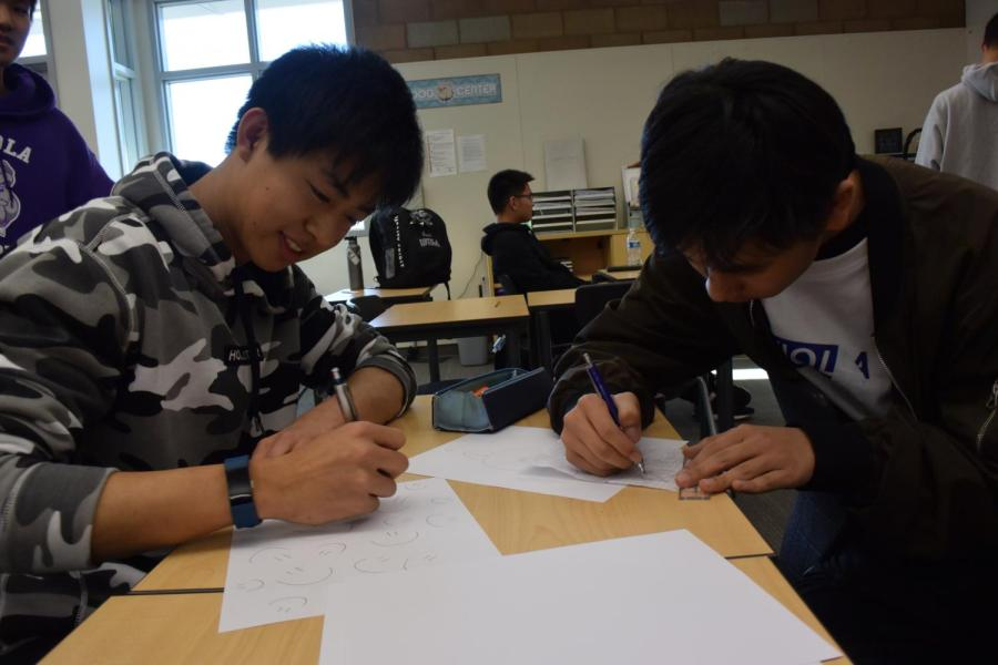 Seniors Leonard Yu and Ryan Shih work out a practice problem together on the day of the AMC exam.