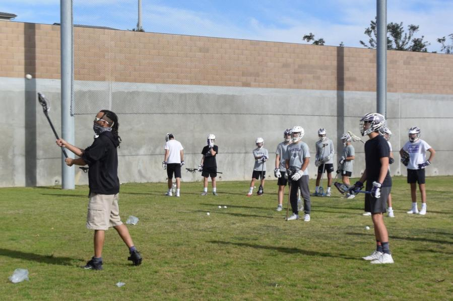 """Coach Brendan Murphy says that as a fiction-lover and a fan of """"Star Wars"""" and """"The Lord of the Rings,"""" the sword-like movements of lacrosse featured attracted him to the sport more than others."""