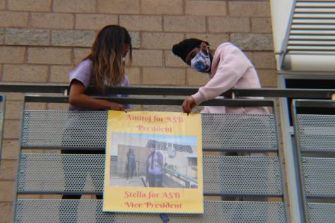 Vice president candidate and junior Stella Jung and newly elected ASB president and junior Amitoj Singh hang posters around Portola High to publicize their campaign. ASB candidates used a combination of posters and flyers and hung them on stairwells and bulletin boards.