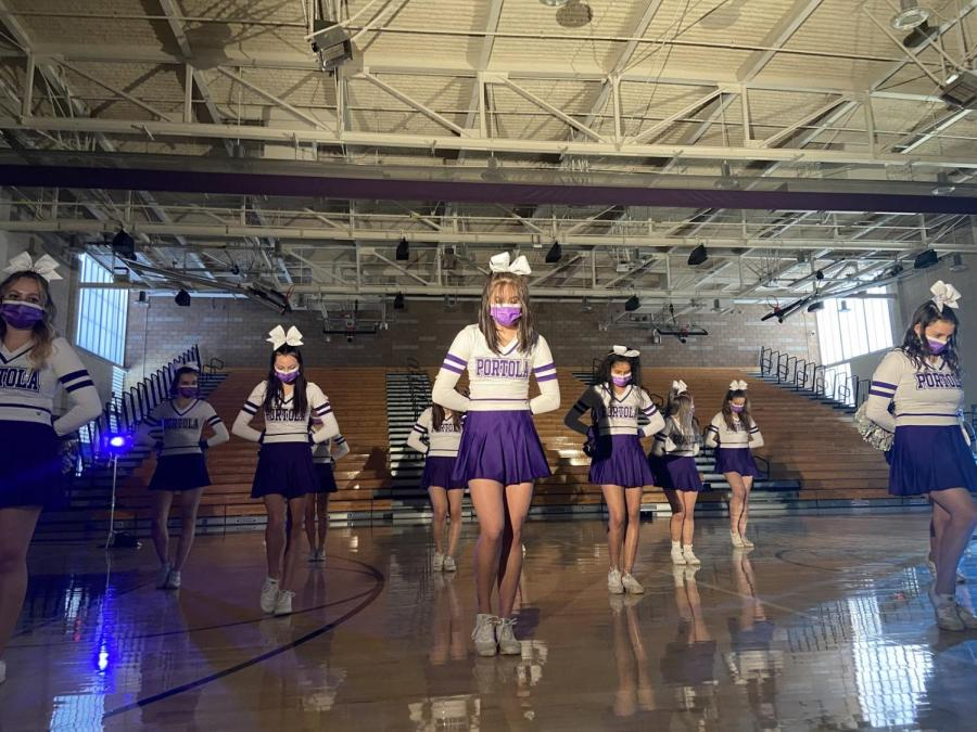 """Senior Emily Wei takes center stage in cheer's performance of the song """"Ready to Ride,"""" which they have been learning since February."""