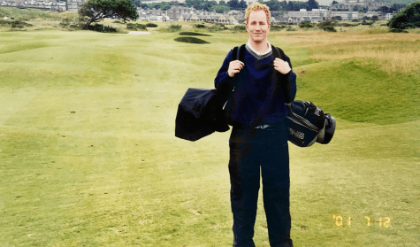 While on a trip to the United Kingdom, a newly college-graduated Wind Ralston stands on the St. Andrews golf course, which is regarded as the birthplace of golf in the 15th century, according to Guinness World Records.