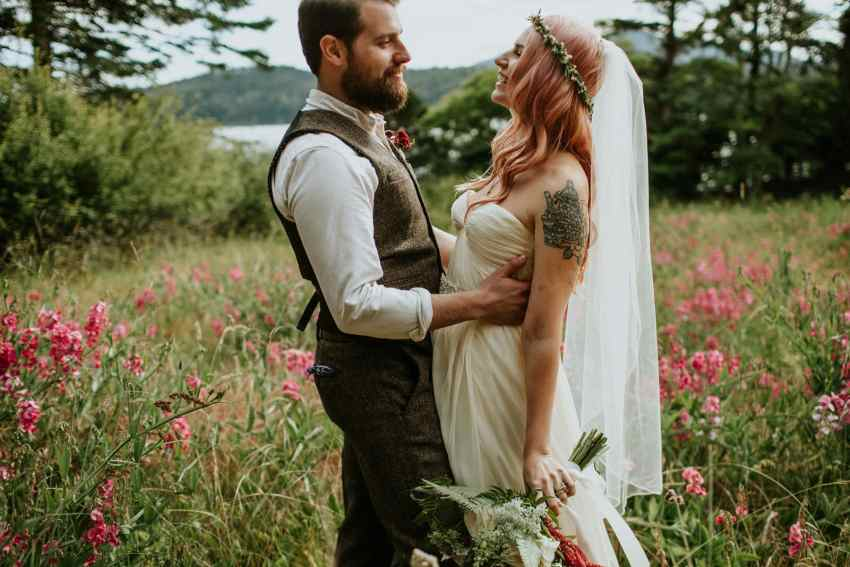 bride and groom in flower field orcas island