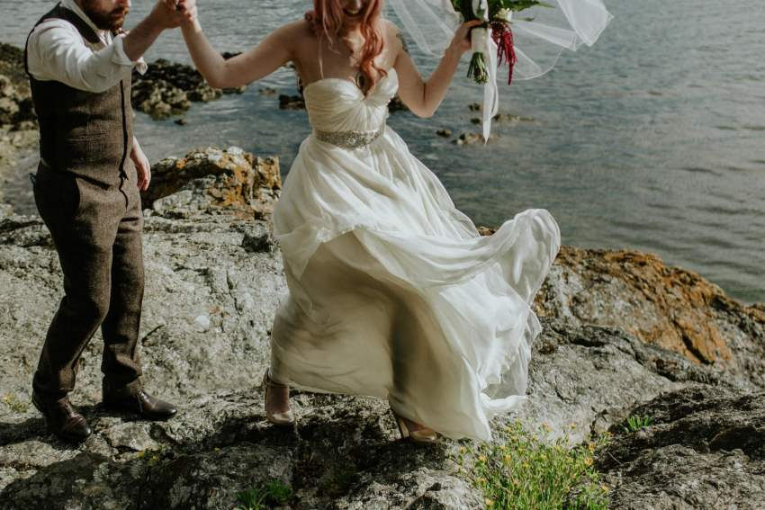 bohemian sarah seven wedding dress blowing in wind