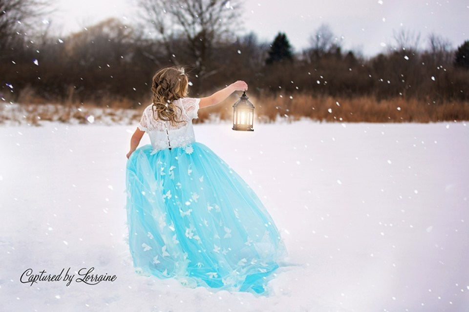 Princess with with lantern in snow
