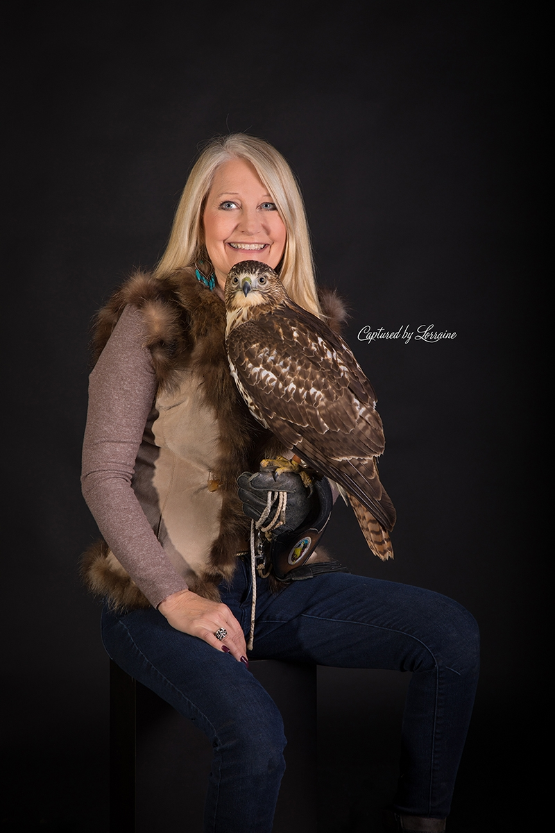 Falconer with Redtailed Hawk