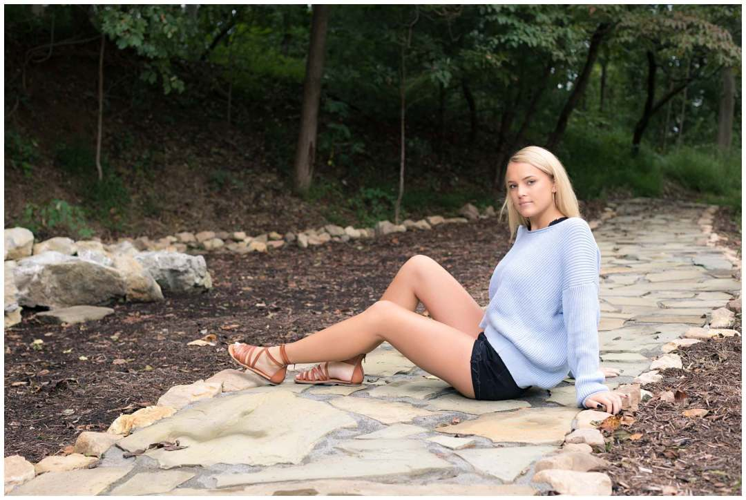 Outdoor senior portrait on a stone pathway