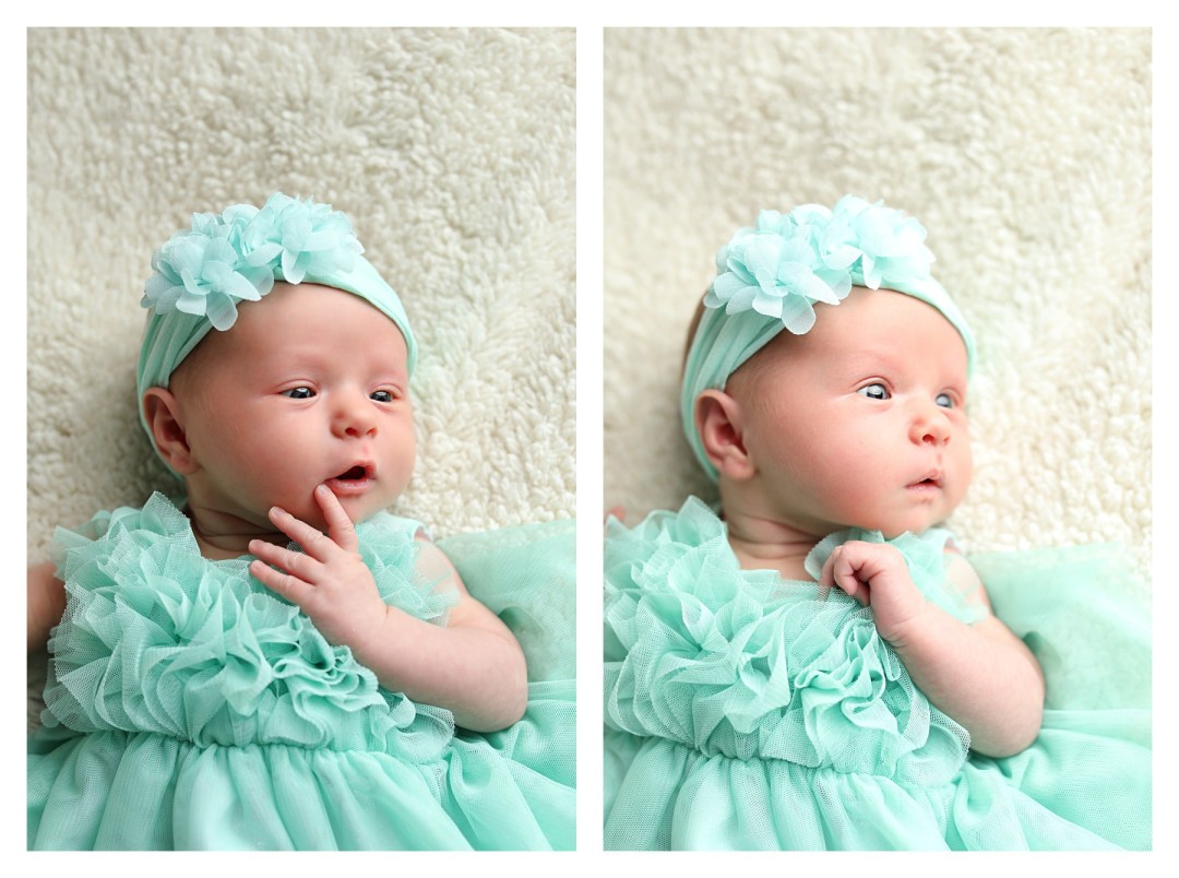 newborn girl in teal dress