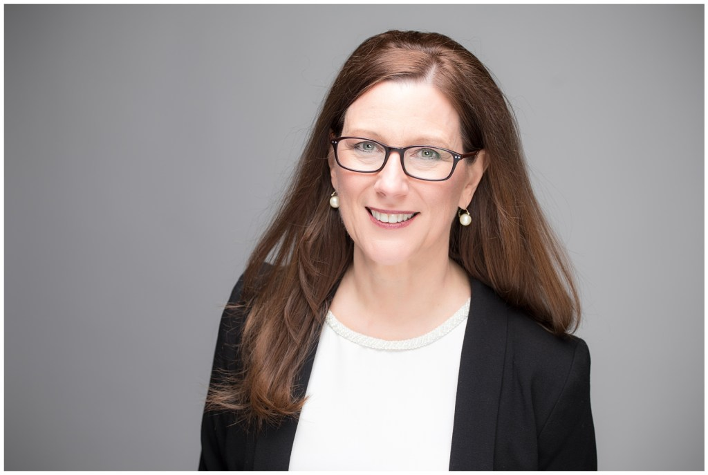headshot of professional woman consulting business