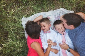 family laughing on blanket