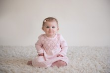 baby girl sitting in pink