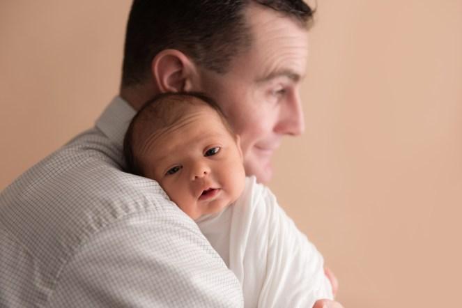 baby on dads shoulder