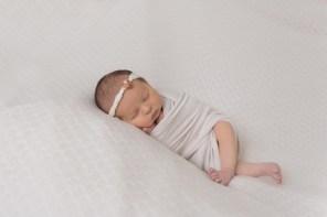 newborn girl wrapped