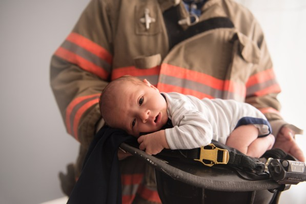baby in dads fire hat