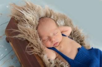 newborn boy in nest