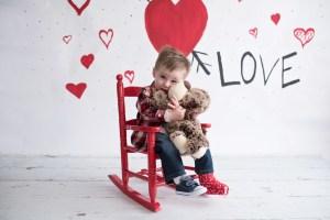 valentines day mini boy hugging bear