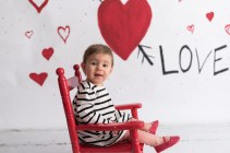 valentines day mini girl in rocking chair