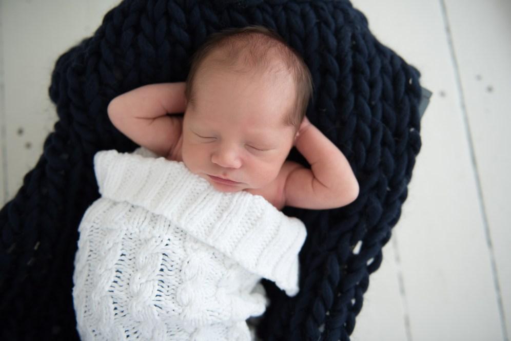 baby boy on navy bump blanket
