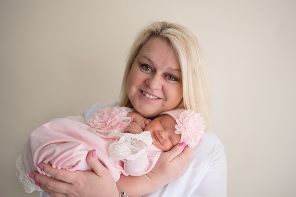 baby girl smiling with mom