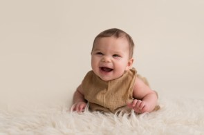 baby girl laughing on belly