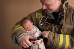 baby in dads arms firefighter