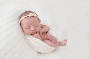 neutral white baby girl nest