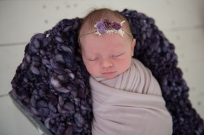 baby in girl in purple wrap