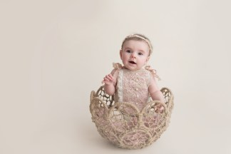 baby girl in basket