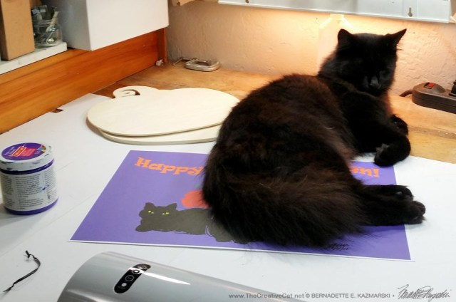 Hamlet keeps the placemat print in place while I heat up the laminator.