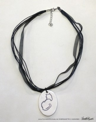 "Sample of multi-strand cord with ""Back to Front"" pendant, 1"" x 1.5"" oval."