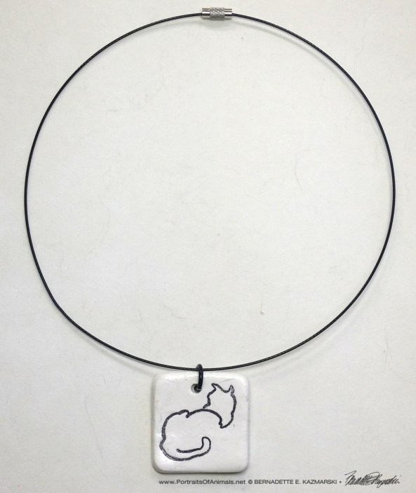 """Sample of wire cord with """"Back to Front"""" pendant, 1"""" x 1"""" square."""
