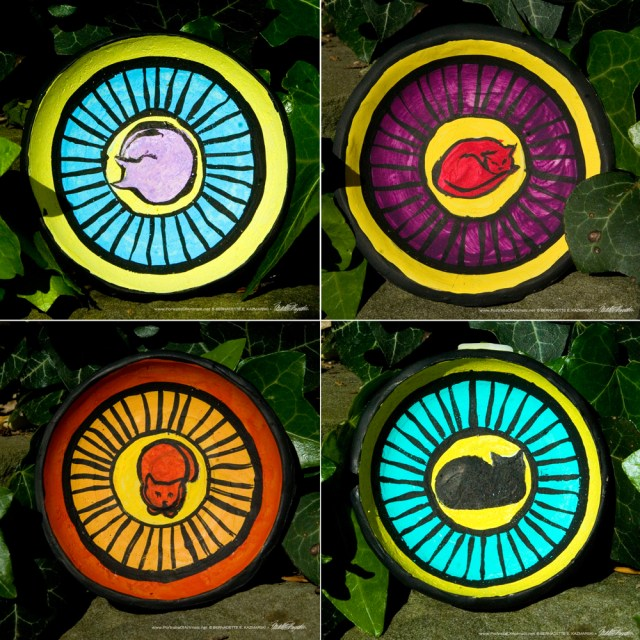 Four colorful trinket dishes.