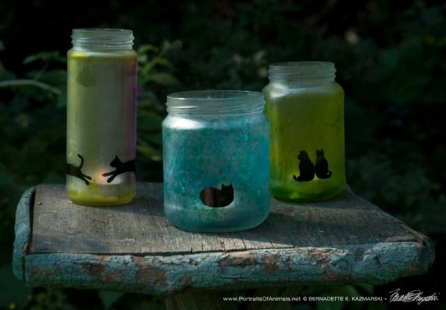 Feline Votives made from repurposed condiment jars.