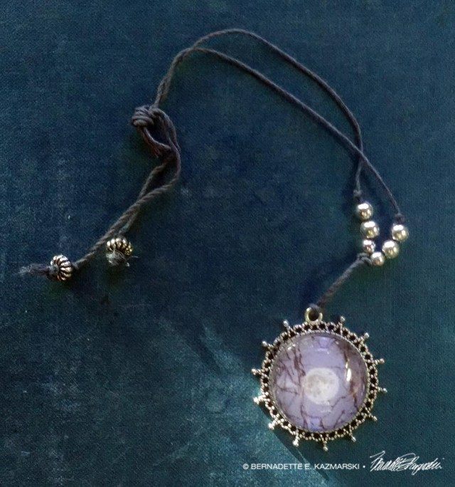 Sycamore Moon cabochon pendant with beaded cord.