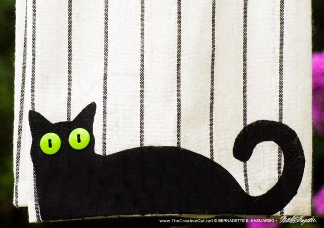 Bella! dishtowel on patterned towel, pattern A, wide stripe.