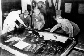 Monuments Man George Stout moves the central panel of the Ghent Altarpiece in Altaussee, Austria in July of 1945. AP Photo/National Archives and Records Administration