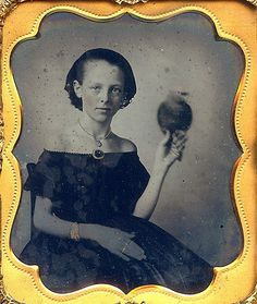 Daguerrotype Girl with African Grey (amazing given the exposure time for taking daguerrotypes)