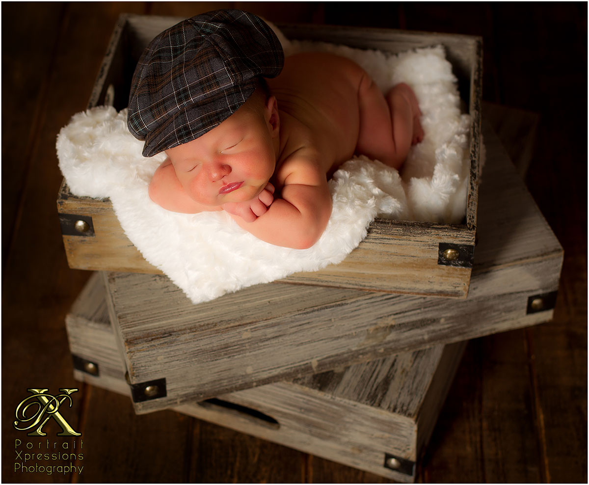newborn baby wearing cap