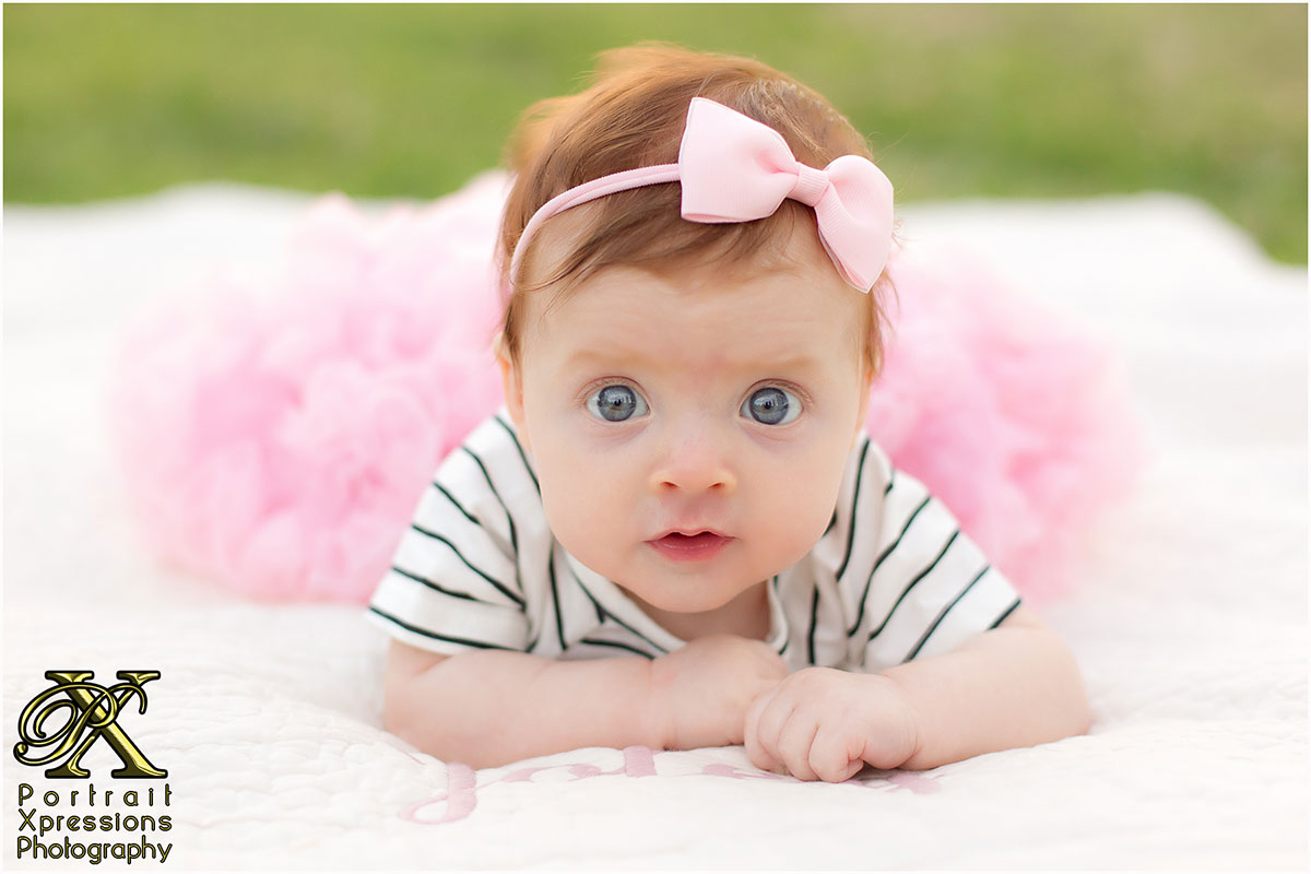 portrait session with baby in pink