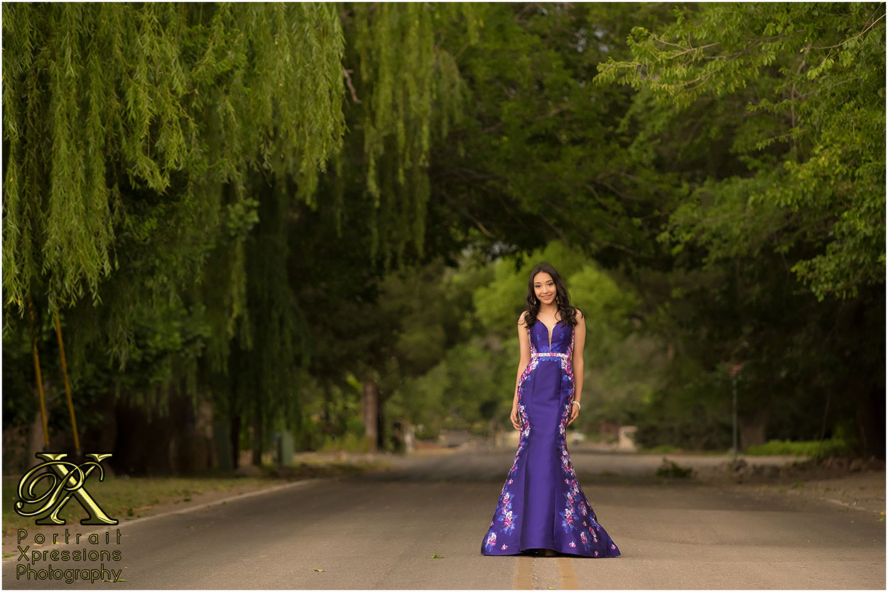 high school senior in purple dress